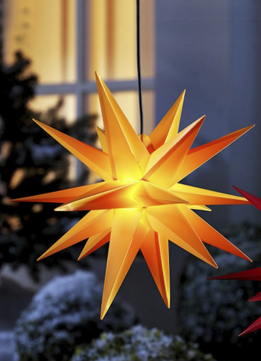Image of Beleuchteter Weihnachtsstern in verschiedenen Farben