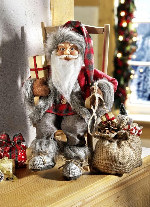 Weihnachtsmann auf Schaukelstuhl